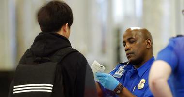 A Transportation Security Administration employee checks an air traveler's identification at Hartsfield Jackson Atlanta International Airport Monday, Jan. 7, 2019, in Atlanta.