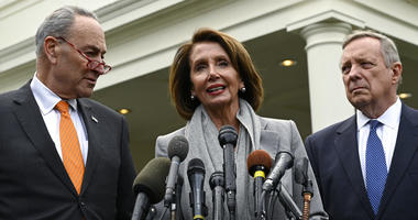 Nancy Pelosi, center, standing with Chuck Schumer, left, and Dick Durbin