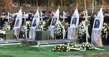 Pictures of five girls who died in an entertainment escape room fire last week, during their joint burial at a cemetery in Koszalin, northern Poland, on Thursday, Jan. 10, 2019.
