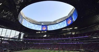 In this Sunday, Dec. 2, 2018, photo, the Atlanta Falcons play the Baltimore Ravens in the Mercedes-Benz stadium during the second half of an NFL football game, in Atlanta.
