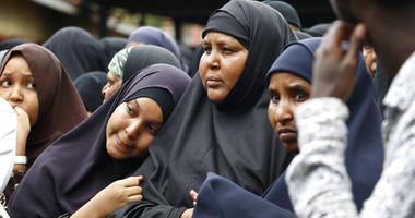 Family members including the mother of Abdalla, center, prepare to pray over the bodies of Abdalla Dahir and Feisal Ahmed, who were both killed in Tuesday's attack, at a mosque in Nairobi, Kenya Wednesday, Jan. 16, 2019.