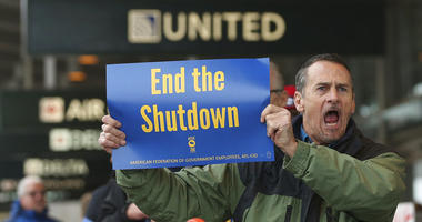 Several dozen federal employees and supporters demonstrated at the Sacramento International Airport calling for President Donald Trump and Washington lawmakers to end then partial government shutdown, Wednesday, Jan. 16, 2019, in Sacramento, Calif.