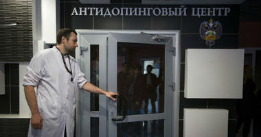 FILE - In this Tuesday, May 24, 2016 file photo, Grigory Dudko opens a door for journalists during a visit to Russia's national drug-testing laboratory in Moscow, Russia.