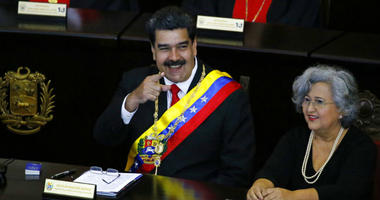 Venezuelan President Nicolas Maduro points to someone in the crowd as he sits inside the Supreme Court for an annual ceremony that marks the start of the judicial year in Caracas, Venezuela, Thursday, Jan. 24, 2019.