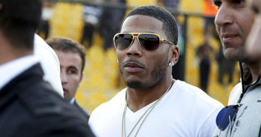 FILE- In this March 13, 2015 file photo, rapper Nelly approaches the stage for a concert in Irbil, northern Iraq.
