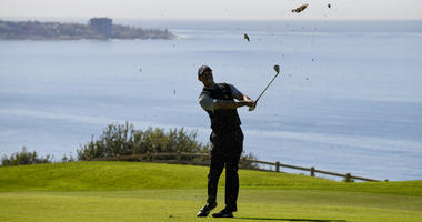 Tiger Woods hits his second shot on the 16th hole during the second round of the Farmers Insurance Open golf tournament on the North Course at the Torrey Pines on Friday, Jan. 25, 2019, in San Diego.
