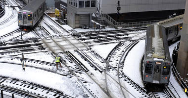 Chicago's El trains move along snow-covered tracks Monday, Jan. 28, 2019, in Chicago. The plunging temperatures expected later this week that have forecasters especially concerned.
