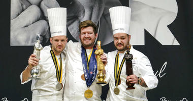"""Kenneth Toft-Hansen of Denmark, center, celebrates on the podium after winning the final of the """"Bocuse d'Or"""" (Golden Bocuse) trophy, in Lyon, central France, ahead Sebastian Gibrand of Sweden, left, who finished second, and Christian Andre Pettersen, rig"""