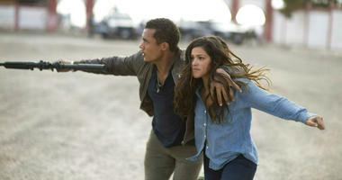 """This image released by Sony Pictures shows Ismael Cruz, left, and Gina Rodríguez in a scene from """"Miss Bala."""""""