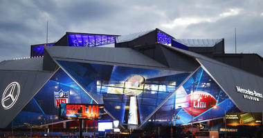Mercedes-Benz Stadium is lit up ahead of Sunday's NFL Super Bowl 53 football game between the Los Angeles Rams and New England Patriots in Atlanta, Saturday, Feb. 2, 2019.