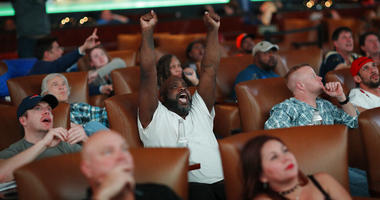 Christopher McCray, of Henderson, Nev., reacts while watching Super Bowl LIII at the Westgate Superbook sports book, Sunday, Feb. 3, 2019, in Las Vegas.