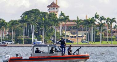 FILE - In this Nov. 22, 2018 photo, a U.S. Coast Guard patrol boat passes President Donald Trump's Mar-a-Lago estate in Palm Beach, Fla.