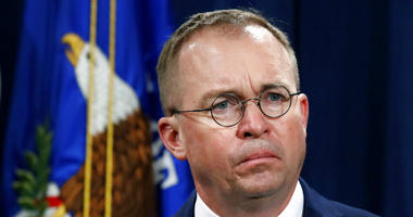 FILE- In this July 11, 2018, file photo Mick Mulvaney, acting director of the Consumer Financial Protection Bureau (CFPB), and Director of the Office of Management, listens during a news conference at the Department of Justice in Washington.