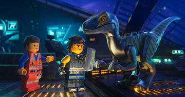 "This image released by Warner Bros. Pictures shows the characters Emmet, left, and Rex Dangervest, center, both voiced by Chris Pratt, in a scene from ""The Lego Movie 2: The Second Part."""