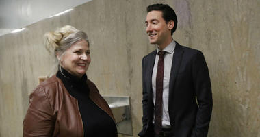 Sandra Merritt, left, smiles as she talks with David Daleiden outside of a courtroom in San Francisco, Monday, Feb. 11, 2019.