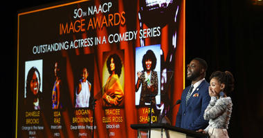 Logan Browning, right, reacts as Winston Duke announces her as a nominee for the 50th annual NAACP Image Awards during TV One's Winter Television Critics Association Press Tour on Wednesday, Feb. 13, 2019, in Pasadena, Calif.