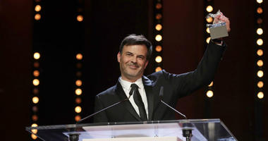 Director Francois Ozon holds aloft the Silver Bear grand jury prize for the film 'By the Grace of God' onstage at the award ceremony of the 2019 Berlinale Film Festival in Berlin, Germany, Saturday, Feb. 16, 2019.