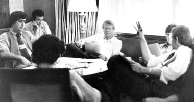 In this Tuesday, July 14, 1976 file photo, Jimmy Carter, center, meets with his staff, from back left, Pat Caddell, Jerry Rafshoon, his son, Chip and Jody Powell, and front left, Pat Anderson, at the Americana Hotel in New York.