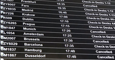 A departure board showing the BMI flights cancelled