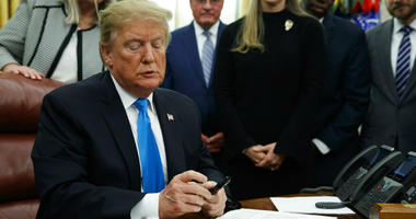 """President Donald Trump pauses during a signing event for """"Space Policy Directive 4"""" in the Oval Office of the White House, Tuesday, Feb. 19, 2019, in Washington."""