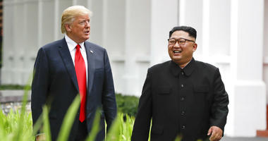 FILE - In this June 12, 2018, file photo, U.S. President Donald Trump, left, and North Korea leader Kim Jong Un walk from their lunch at the Capella resort on Sentosa Island in Singapore.