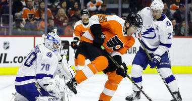 Tampa Bay Lightning's Louis Domingue (70) blocks a shot as Philadelphia Flyers' James van Riemsdyk (25) and Lightning's Ryan McDonagh (27) look for the rebound during the second period of an NHL hockey game, Tuesday, Feb. 19, 2019, in Philadelphia.