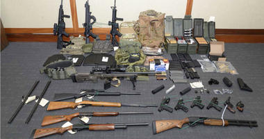 This image provided by the U.S. District Court in Maryland shows a photo of firearms and ammunition that was in the motion for detention pending trial in the case against Christopher Paul Hasson.
