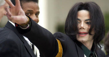 FILE - In this March 2, 2005 file photo, pop icon Michael Jackson waves to his supporters as he arrives for his child molestation trial at the Santa Barbara County Superior Court in Santa Maria, Calif.