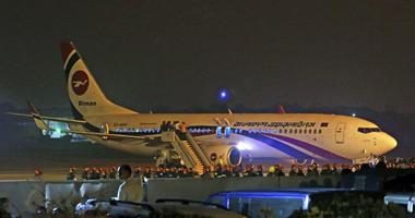 Bangladesh's state-run Biman Bangladesh Airlines flight is seen after it made an emergency landing at the airport in Chittagong, Bangladesh, Sunday, Feb.24, 2019.