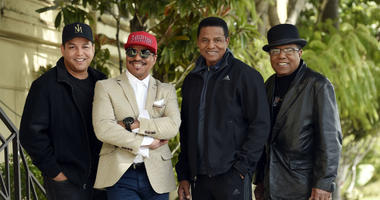 In this Tuesday, Feb. 26, 2019 photo, Marlon Jackson, second from left, Jackie Jackson, second from right, and Tito Jackson, far right, brothers of the late musical artist Michael Jackson, and Tito's son Taj, far left, pose for a portrait outside.