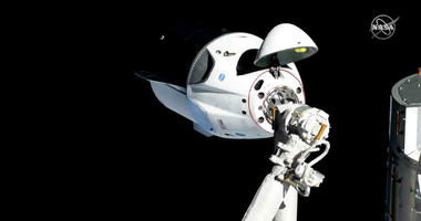 In this photo provided by NASA, the SpaceX Crew Dragon is pictured about 20 meters (66 feet) away from the International Space Station's Harmony module, Sunday, March 3, 2019.
