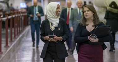"Rep. Ilhan Omar, D-Minn., walks to the chamber Thursday, March 7, 2019, on Capitol Hill in Washington, as the House was preparing to vote on a resolution to speak out against, as Speaker of the House Nancy Pelosi said, ""anti-Semitism, anti-Islamophobia, a"