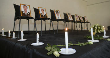 Framed photographs of seven crew members are displayed at a memorial service held by an association of Ethiopian airline pilots, in Addis Ababa, Ethiopia Monday, March 11, 2019.