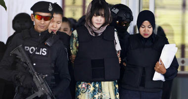 FILE - In this April 5, 2018, file photo, Vietnamese Doan Thi Huong, center, is escorted by police as she leaves after a court hearing at the Shah Alam High Court in Shah Alam, Malaysia.