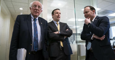 From left, Sen. Bernie Sanders, I-Vt., Sen. Chris Murphy, D-Conn., and Sen. Mike Lee, R-Utah, meet before holding a news conference on the Senate vote on ending U.S. support for the Saudi Arabian-led coalition fighting in Yemen, at the Capitol in Washingt