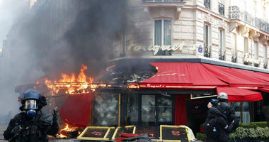 Paris famed restaurant Fouquet's burns on the Champs Elysees avenue during a yellow vests demonstration.