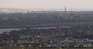 The Islamic State group's last pocket of territory in Baghouz, Syria, as seen from a distance.