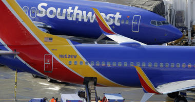 Southwest Airlines planes are loaded at Seattle-Tacoma International Airport in Seattle.