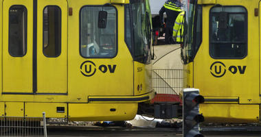 A body is covered with a white sheet after a shooting in a tram in Utrecht, Netherlands.