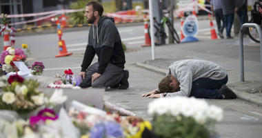 Mourners pray near the Linwood mosque in Christchurch, New Zealand.