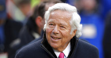 New England Patriots owner Robert Kraft walks on the field before the AFC Championship NFL football game in Kansas City.