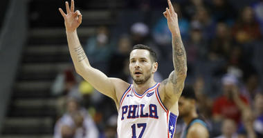 Philadelphia 76ers' JJ Redick (17) reacts after making a 3-point basket against the Charlotte Hornets during the first half of an NBA basketball game in Charlotte, N.C.