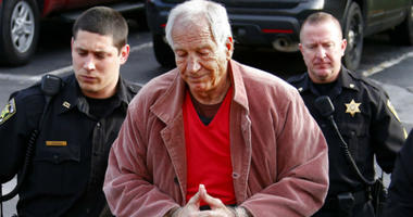 Former Penn State University assistant football coach Jerry Sandusky, center, arrives at the Centre County Courthouse for a hearing about his appeal on his child sex-abuse conviction, in Bellefonte, Pa.