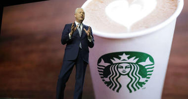 Starbucks CEO Kevin Johnson speaks at the company's annual shareholders meeting in Seattle.