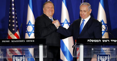 U.S. Secretary of State Mike Pompeo, left, shakes hands with Israeli Prime Minister Benjamin Netanyahu.