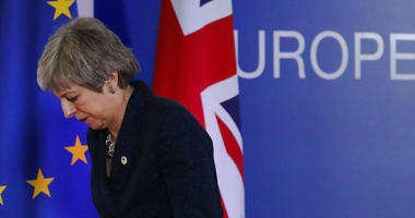 British Prime Minister Theresa May leaves after addressing a media conference at an EU summit in Brussels.