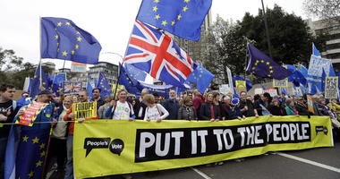 Demonstrators hold a banner during a Peoples Vote anti-Brexit march in London, Saturday, March 23, 2019. The march, organized by the People's Vote campaign is calling for a final vote on any proposed Brexit deal.
