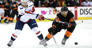 Philadelphia Flyers right wing Jakub Voracek (93), of the Czech Republic, collides with Washington Capitals goaltender Braden Holtby (70) during the second period of an NHL hockey game.