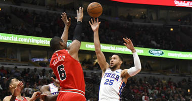 Philadelphia 76ers guard Ben Simmons (25) shoots as Chicago Bulls forward Cristiano Felicio (6) defends during the first half of an NBA basketball game.