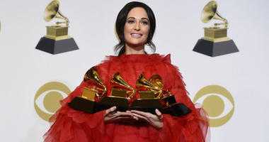 "\Kacey Musgraves, winner of the awards for best country album for ""Golden Hour"", best country song for ""Space Cowboy"", best country solo performance for ""Butterflies"" and album of the year for ""Golden Hour"" poses in"